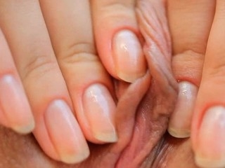 Beauty takes vibrator and pushes it in her luscious loving hole