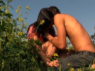 Brunette Hair exposes her sexy body and enjoys sex in flower region