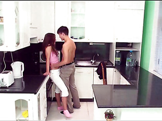 Longhaired redhead hottie gets orgasms from sex in the kitchen