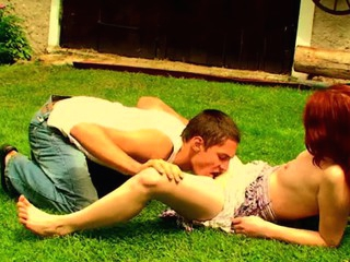 Filthy redhead whore is fucking round her partner on the grass