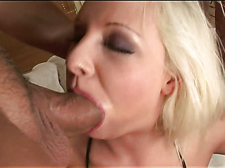 Two cute chicks take up with the tongue snatches and play with large sex toy