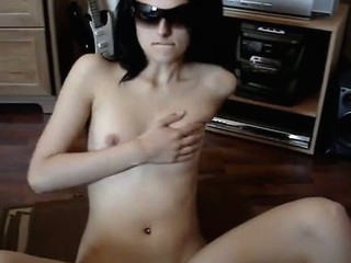 Very beautiful cutie disrobes and masturbates in advance of camera