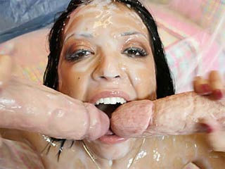 Sexy brunette sucking two cocks and taking cumshot